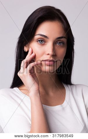 Portrait Of Beautiful Brunette Woman On White Background