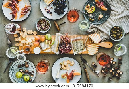 Seasonal Picnic With Rose Wine, Cheese, Charcuterie, Nuts And Fruits