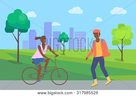 Boy Rollerblading In Casual Clothes And Afro-american Woman Riding On Bike, People In City Part. Man