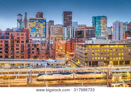 Denver, Colorado, USA downtown cityscape over the train station at twilight.