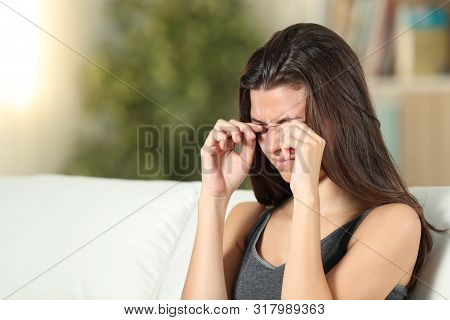 Girl Suffering Itching Scratching Eyes Sitting On A Couch In The Living Room At Home