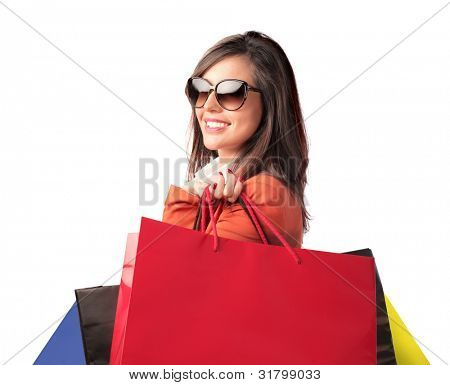 Smiling beautiful woman holding some shopping bags