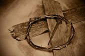 closeup of a representation of the Jesus Christ crown of thorns, cross and nail poster