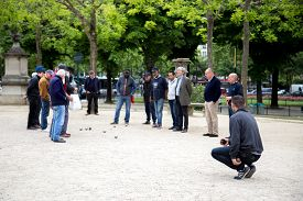 Paris, France - May 11, 2017: Group Of Men Playing Petanque In A Public Park.
