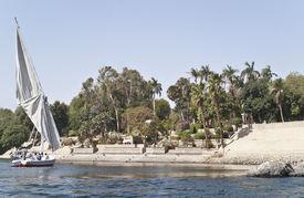 Egyptian sailing boat in front of Botanical garden, Aswan, Egypt.