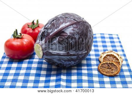 Red Cabbage with red Tomatos on Underlayment