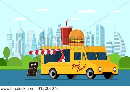 Fast Food Yellow Truck In Modern City Park. Burger And Beverage On Van Roof. Hamburger With Soda Car