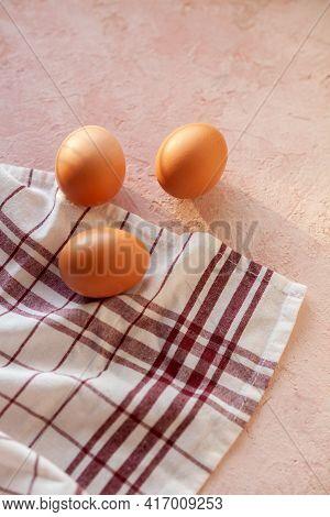 Brown Chicken Eggs On White Textile Cotton Towel