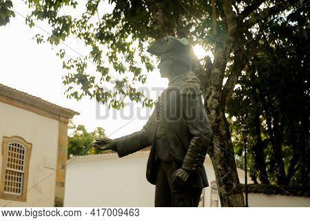 Tiradentes, Minas Gerais, Brazil - February 20, 2021: Tiradentes Metal Statue Representing The Young