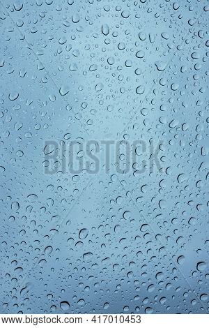 Wet Windshield, Taken From Inside The Car.rain Falls On The Surface Of A Car Glass Window With A Gra