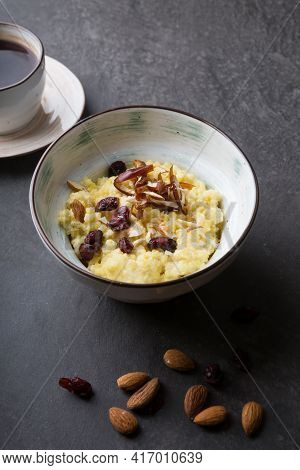 Cooked Porridge Served With Almonds In A Bowl