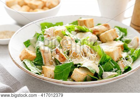 Caesar Salad With Parmesan Cheese, Grilled Chicken Meat And Croutons