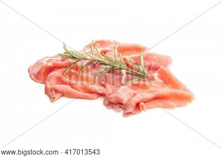 Sliced carpaccio. Raw beef meat isolated on white background.