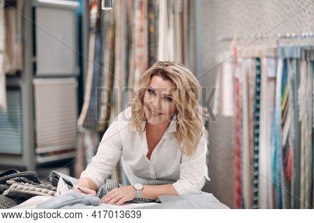 Interior Designer Woman At Work. Design And Interior Decoration Fabric.