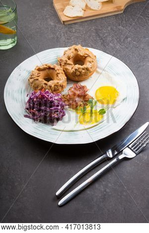 Donuts With Peanut Butter Served With Fried Eggs For Breakfast