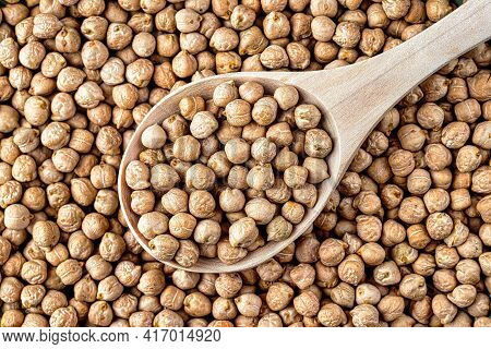 Wooden Spoon Of A Chickpea Bean Seeds. Healthy Vegetarian Nutrition Component.wooden Spoon Of A Chic