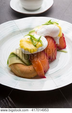 Donuts With Avocado, Salmon And Fried Eggs Served For Breakfast
