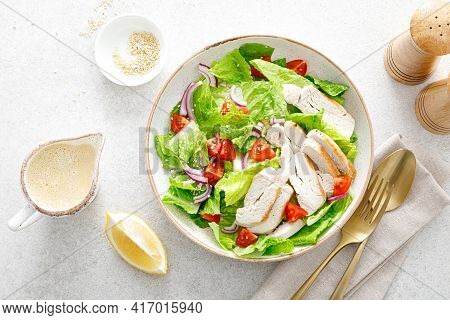 Salad With Romaine Lettuce, Grilled Chicken Meat And Tomatoes