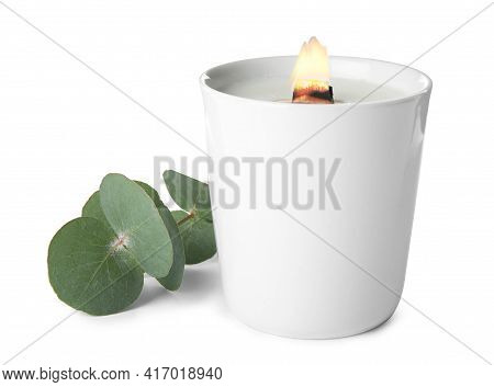 Beautiful Candle With Wooden Wick And Eucalyptus On White Background