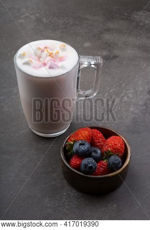 Glass Cup Of Babyccino Drink With Marshmallows And Berries
