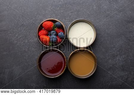 Different Type Of Sauces Set On A Dark Table