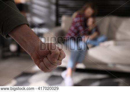 Man Threatening His Wife And Daughter At Home, Closeup. Domestic Violence