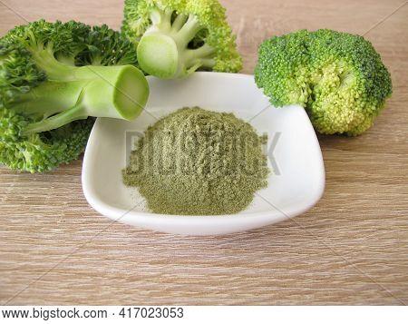Green Broccoli Powder From Dried Broccoli In A Bowl