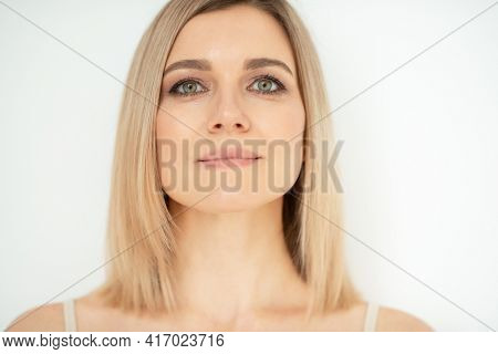 Beautiful calm middle aged woman, natural light. Anti-aging and beauty treatment.