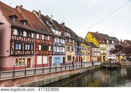 Colmar, France - May 2019: Colourful Traditional Half-timbered Houses On The Quai De La Poissonnerie
