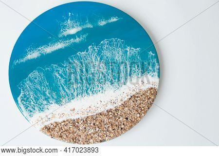 Round Resin Art Painting With Blue Ocean Waves And Beach On White Background. Epoxy Resin Art