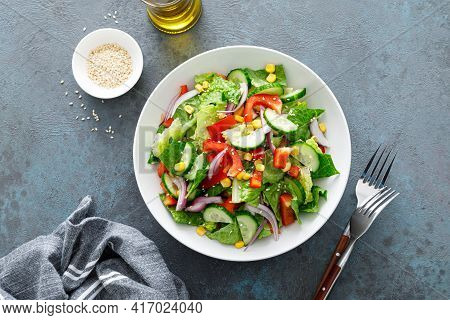 Vegetarian Fresh Vegetable Organic Salad With Cucumber, Red Bell Pepper, Red Onion, Corn And Green L