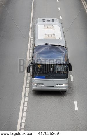 Tourist Bus On A Multi-lane Road. View From Above
