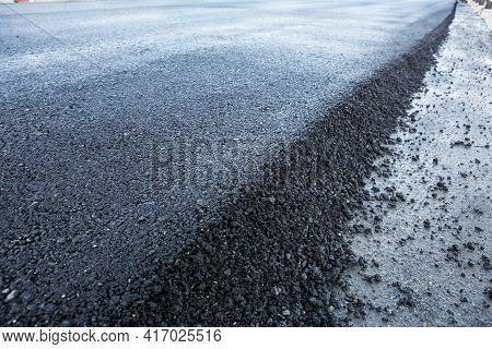 New Layer Of Asphalt On Highway. Close-up