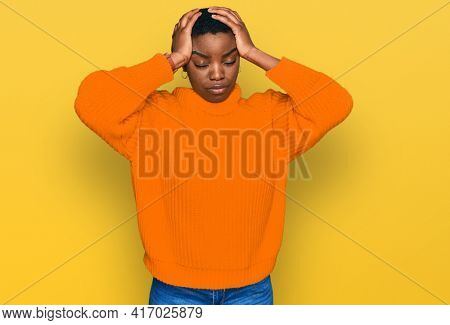 Young african american woman wearing casual clothes suffering from headache desperate and stressed because pain and migraine. hands on head.