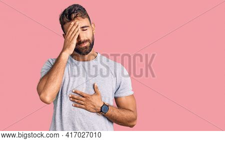 Young hispanic man wearing casual clothes touching forehead for illness and fever, flu and cold, virus sick