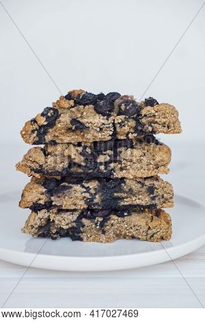 Homemade Oatmeal Scones With Berries Stacked On White Plate. Vegan Sweet Baked Food. Gluten Free Pas