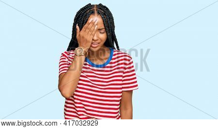 Beautiful hispanic woman wearing casual clothes yawning tired covering half face, eye and mouth with hand. face hurts in pain.