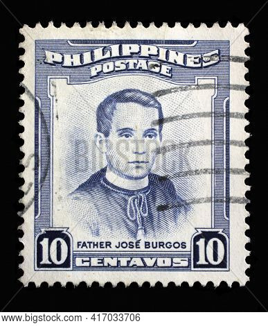 ZAGREB, CROATIA - SEPTEMBER 18, 2014: Stamp printed in Philippines shows portrait of Jose Burgos (1837-1872) priest and philosopher, Personalities series, circa 1955