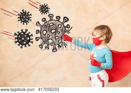 Superhero Child Beat Drawing Virus. Super Hero Kid Against Grunge Wall. Coronavirus Covid-19 Pandemi