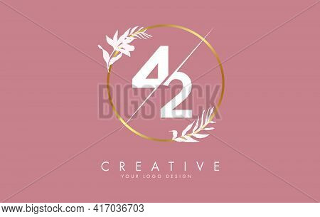 Number 42 4 2 Logo Design With Golden Circle And White Leaves On Branches Around. Vector Illustratio