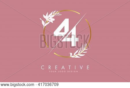 Number 44 4 Logo Design With Golden Circle And White Leaves On Branches Around. Vector Illustration