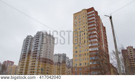 High-rise Residential Buildings In A New Area Of The City Built Of Bricks. Against The Background Of