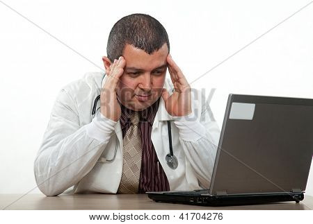 Hispanic American Medical Practitioner Stressing On Computer
