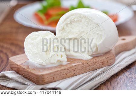 Buffalo Mozzarella, Italian Cheese On Wooden Board.