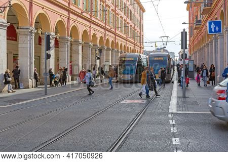 Nice, France - February 3, 2016: Electric Trams And Commuters At Station Platform In Nice, France.