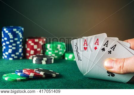 Poker Cards With Five Of A Kind Combination. This Is The Maximum Win. Close Up Of Gambler Hand Takes
