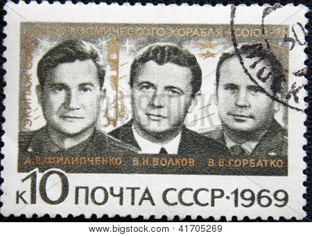 RUSSIA - CIRCA 1971: stamp printed by USSR shows portraits of cosmonauts Filipchenko Volkov Gorbatko