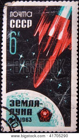 RUSSIA - CIRCA 1971: stamp printed by USSR shows Earth - Moon satellite