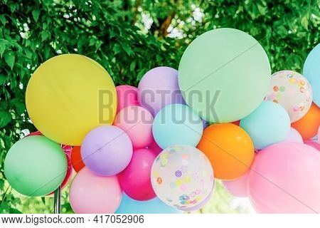 Beautiful Colorful Multicolored Festive Balloons. Multicolored Balloons On Background Of Greenery