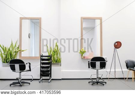 Workplace For Hairdressers In Barber Shop. The Interior Of The Hairdressing Salon With A Professiona